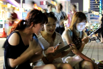 Korean Girls Singing on the Boardwalk