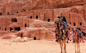 Vendors Sell Rides on Camels, Donkeys, and Horses