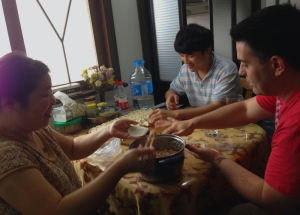 Justin Under the Wing of our Chinese Family - Learning the Ancient, Noble Art of Dumpling-ing...