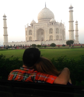 The happy couple relaxing on a bench overlooking the Taj Mahal