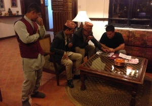 Justin playing Bhag-Chal (Tigers and Goats) with some of our friends at Kantipur