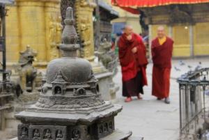 Buddhist Monks Circumnavigating a Stupa; Note the Prayer Wheels (Nepal)