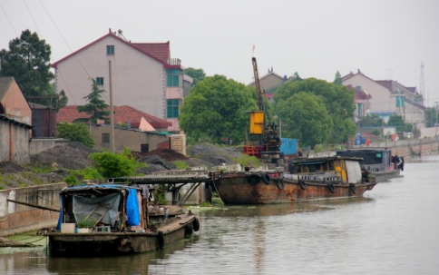 Barges are used for both transporting goods and also for housing...