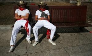 Bull Runners in Pamplona having a post-run rest.
