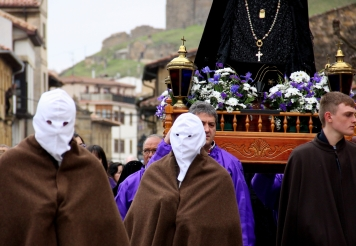 The First Glimpse of the Men in White Masks (and the float of Mourning Mary)