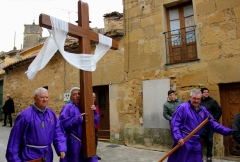 The Men Take Turns Carrying the Cross