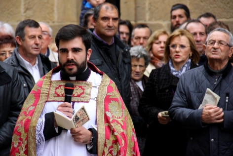 The Priest Reads the Stations of the Cross
