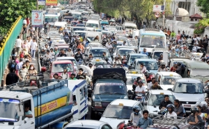 The South Asian Roads are a Veritable Sea of Cars, Trucks, and Bikes...