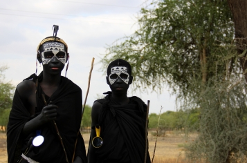 These two Maasai boys are about to be circumsized (hence the face-painting and black clothing)...